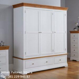 Desain lemari pakaian minimalis modern mewah dan klasik terbaru warna putih gambar model almari baju 3 pintu dan 2 laci cat duco kayu Jepara
