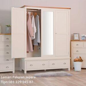 Lemari pakaian minimalis 3 pintu gantung model desain almari baju warna putih terbaru kaca cermin kayu jati dan mahoni Jepara harga murah