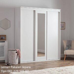 Lemari pakaian minimalis 3 pintu sliding door geser model desain almari baju kaca cermin warna putih kayu Jepara modern terbaru harga murah