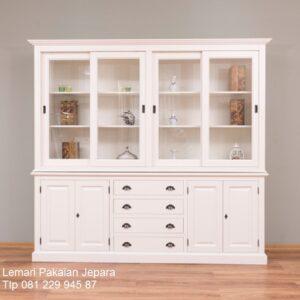 Lemari pajangan kaca minimalis modern dan mewah terbaru model desain buffet hias warna putih cat duco kristal kayu Jepara harga murah